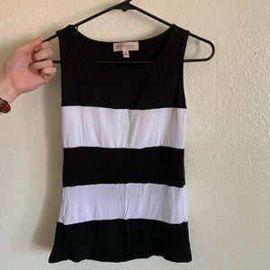 Sleeveless black & white top with draped back